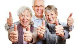 26201482 - three happy senior people holding their thumbs up